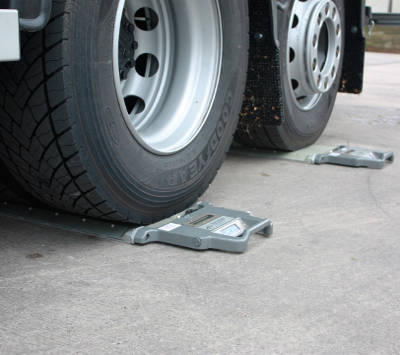Two Axtec Portable Weighpads being used on a vehicle